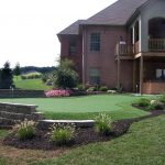 high-class putting green with flags feature in the frontyard