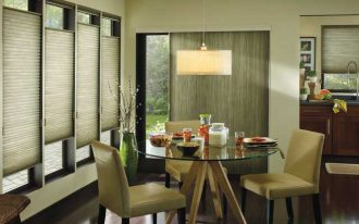 honeycomb window treatment in shabby wood color for sliding glass door simple dining furniture with drinks and foods on the dining table casual and warm pendant lighting fixture dark wood planks floors