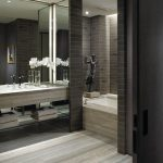 interesing black and gray bathroom with ravishing concrete walling and interesting gray vanities in laminate flooring