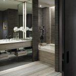 interesing black and gray bathroom with ravishing concrete walling and interesting gray vanities in laminate flooring
