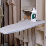 ironing board storage that is united with clothes and shoes storage