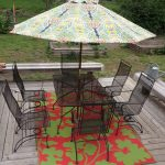 jaunty rug with green flower patterns for outdoor casual black wire patio furniture in black a large shade with beautiful patterns old-style wood planks floor for patio