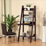 ladder desk in dark-wood finish with white vase ornament and a white cup ornament some books arrangements a laptop unit brown chair with white metal legs laminated-wood floor