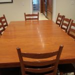 laminate-wood dining table with casual dining chairs made from wood