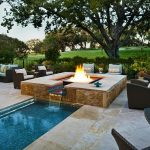 large permanent table with water fountain looks like fire  patio furniture sets large green garden small pool white marble floor