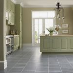 light grey tiles floors top and under light green kitchen cabinets classic-accent pendant lighting  fish-pictures in light green frames