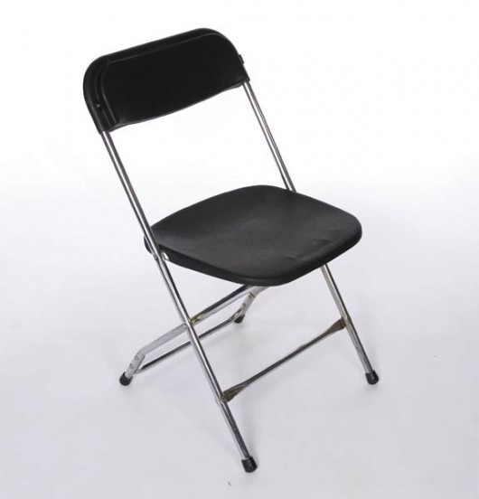 lucite folding chair with black seating and back feature