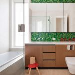 mesmerizing bathroom concept with cute green backsplash also interesting brown cabinet and large white bathtun and floating bidet
