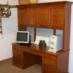 mini wall unit with desk for monitor and another electric office appliance