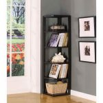 minimalist and casual black corner bookshelves with books collections and ornamental shield a rattan basket for storage two uncolored pictures in big black frames glossy laminate wood floor