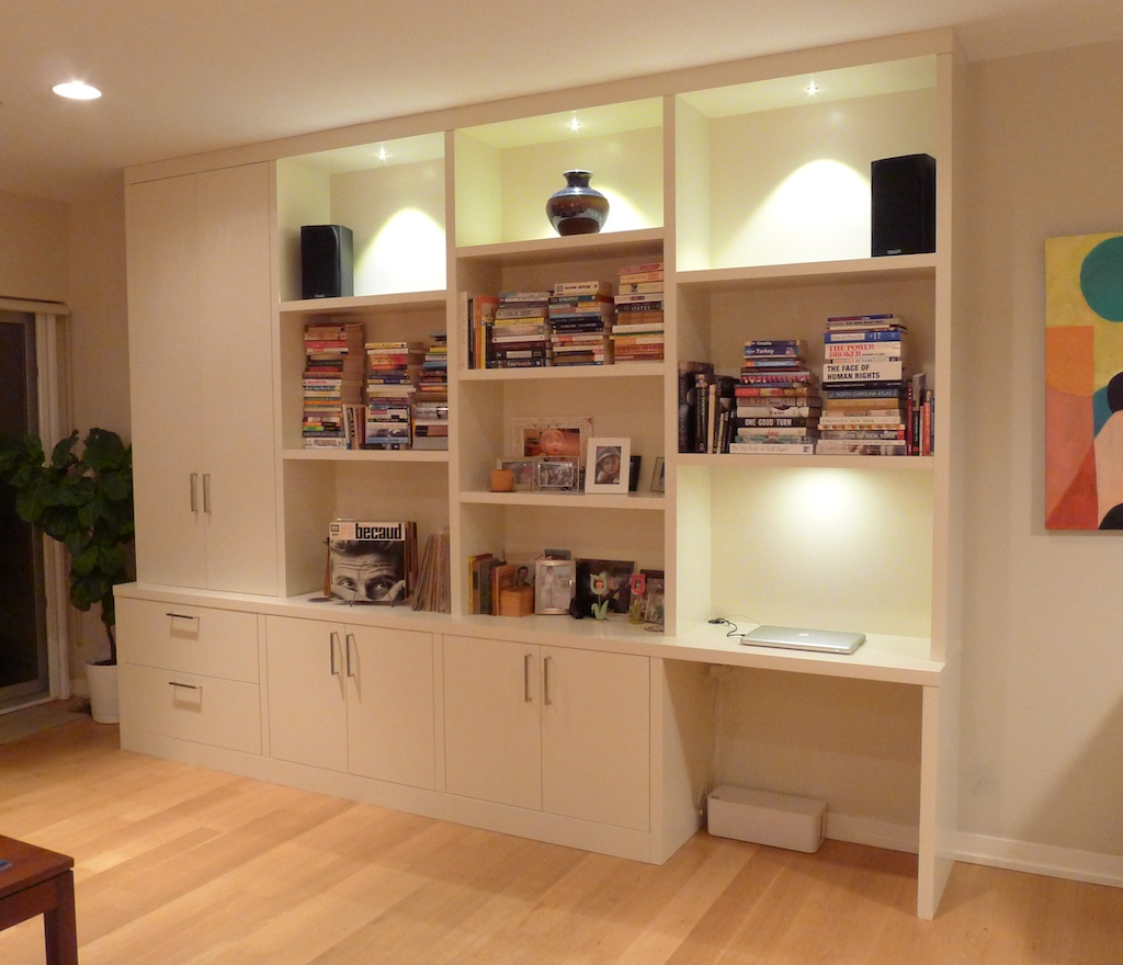 minimalist wall unit for shelves unit and storage with desk piles of