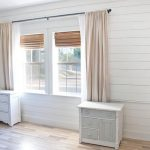 minimalist window curtain in white a pair of single cabinetry  laminated-wood finish floor white wood planks for wall