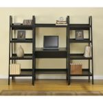 minimalist wood ladder desk in black color piles of books a laptop unit two picture frames