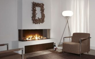 modern minimalist gas fireplace two cozy arm chairs unique stand lighting with  high legs brown carpet