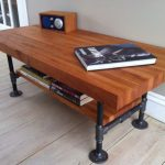 modern-nice-adorable-coolelegant-cool-butcher-block-coffee-table-with-large-wooden-surface-in-brown-accent-with-wooden-legs-and-has-wheels-728x543