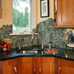 multicolor river rock tiles for kitchen backsplash a kitchen stainless steel sink with double faucets top and under kitchen cabinets black marble countertop
