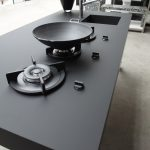 nanotech countertop in black with built-in gas stove and  square nanotech sink and stainless steel faucet
