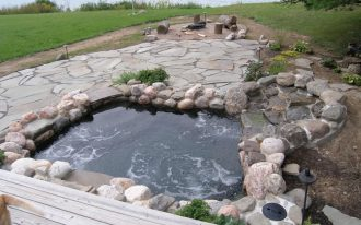 natural  hot tub with natural stone frame log seatings for outdoor