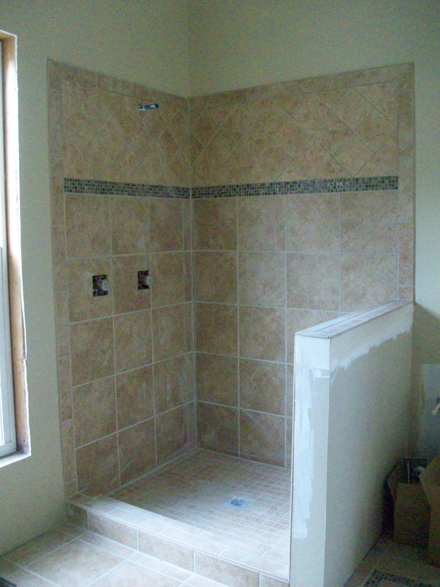 No Door Shower Building With Small Tiles Floor And Large Ceramic Tiled  Shower Wall