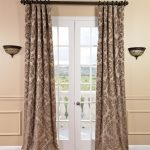 patterned-curtains for floor to curtain rod  twin wall-light fixtures  wood finish floor