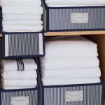 piles of white linens in linen closet storage