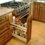 pull-out kitchen drawer under kitchen cabinetry made from hardwood  modern and luxurious kitchen appliance unit  clean wood kitchen floor