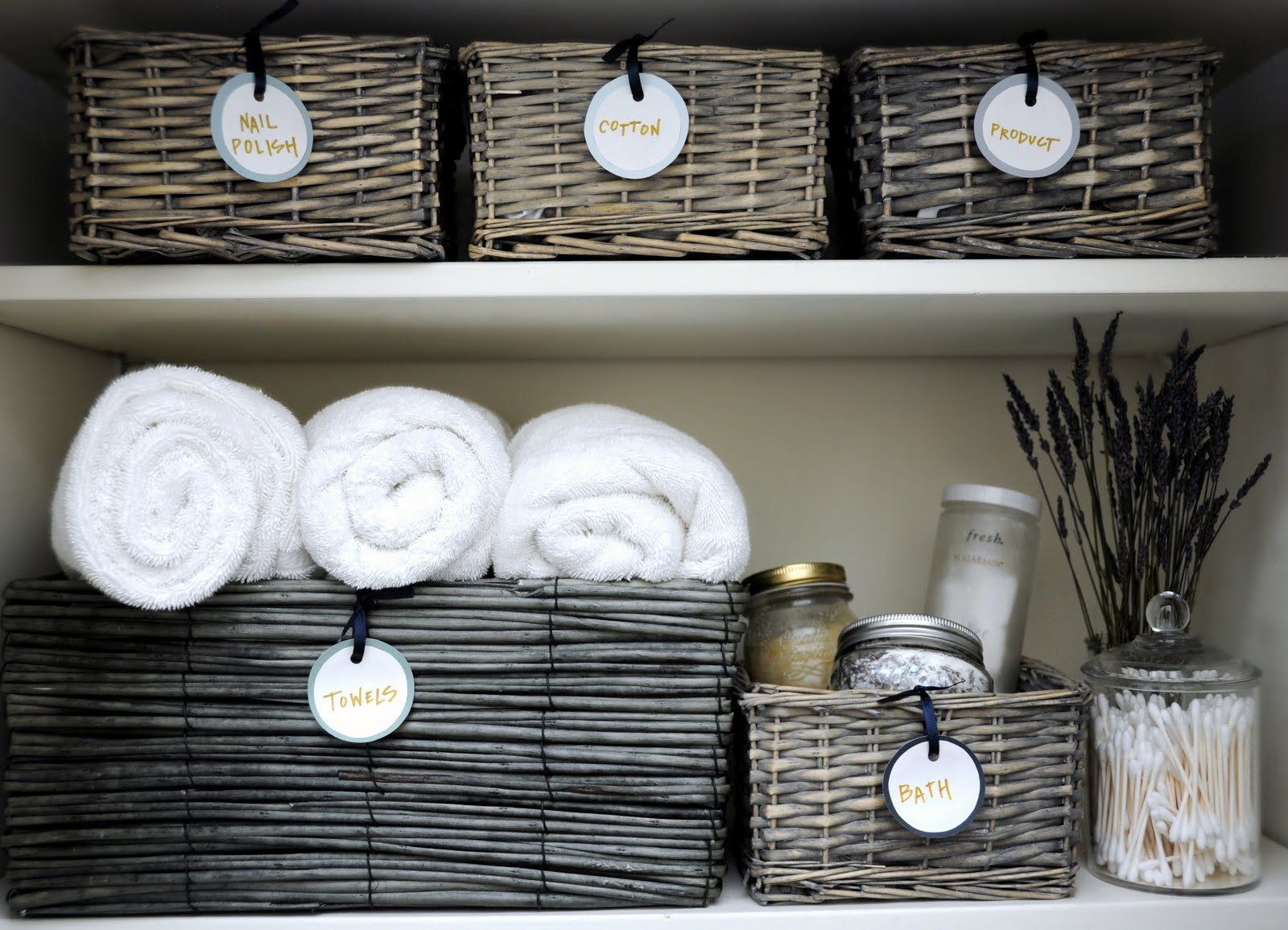 rattan boxes for linen storage with name-tags rolled-white towels bath supplies