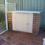 red bricks box for pool filter storage with door feature