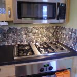 river rock kitchen backsplash tiling four units of modern gas stoves electric oven electric microwave