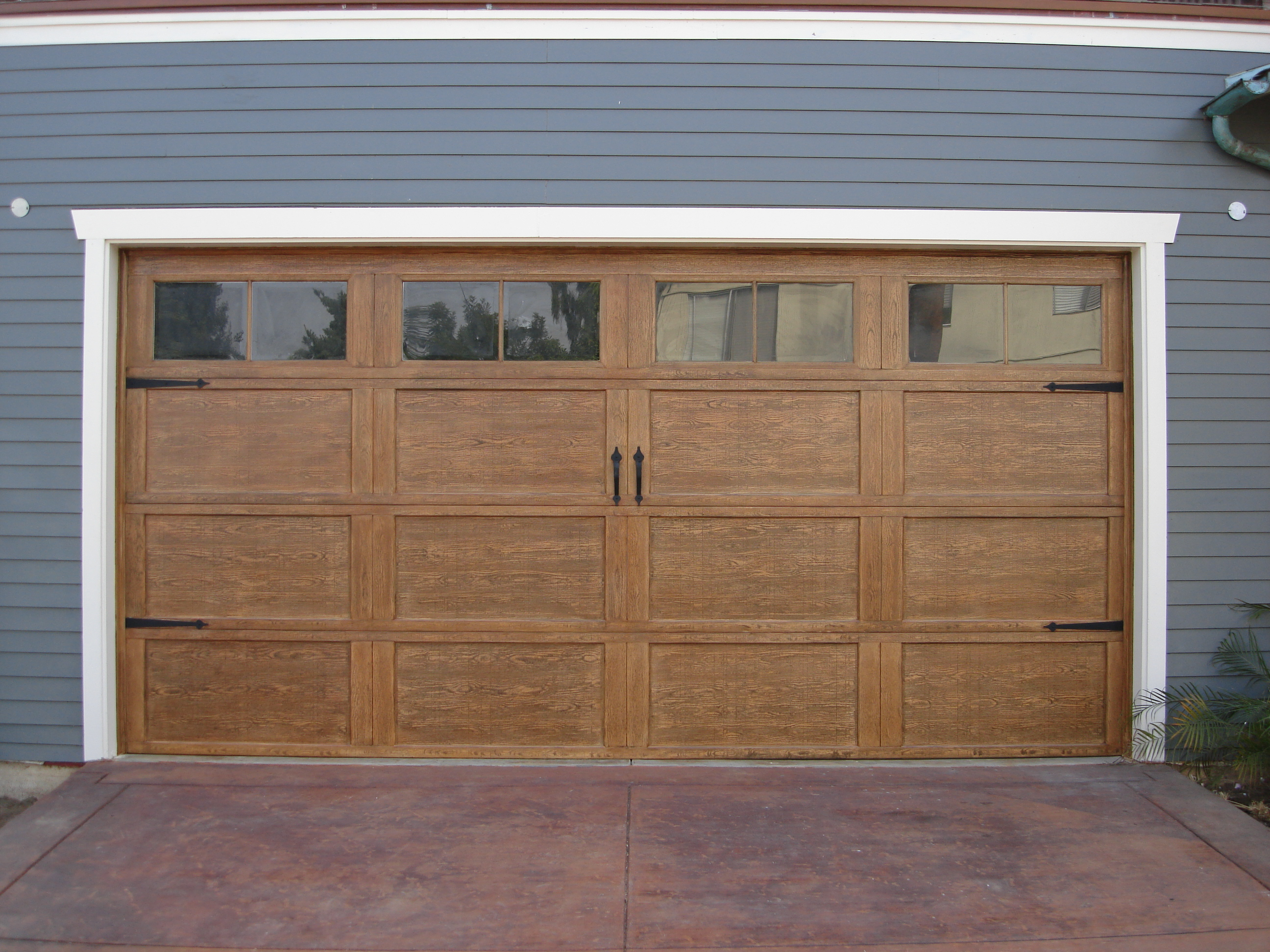 Craftsman style garage doors homesfeed - Making a steel door look like wood ...
