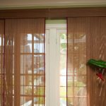 semi-transparant honeycomb window treatment in brown for sliding glass door