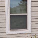 simple and casual look of outdoor window trim in white color
