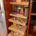 simple pull-out  pantry made from wood with softwood platforms