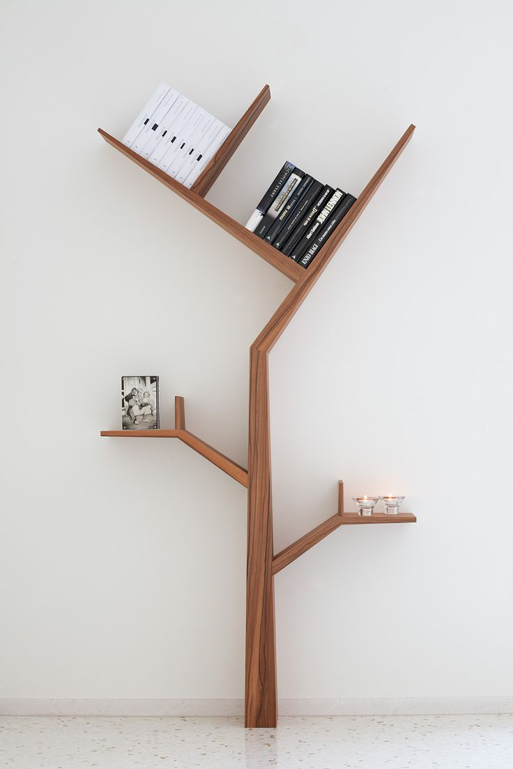 Tree shaped bookshelf find a new way to be crazy in for Minimalist household items