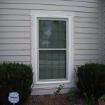 simple white window trim and mould seen from outside
