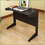 slim computer desk in black  a laptop two books laminated-wood floor