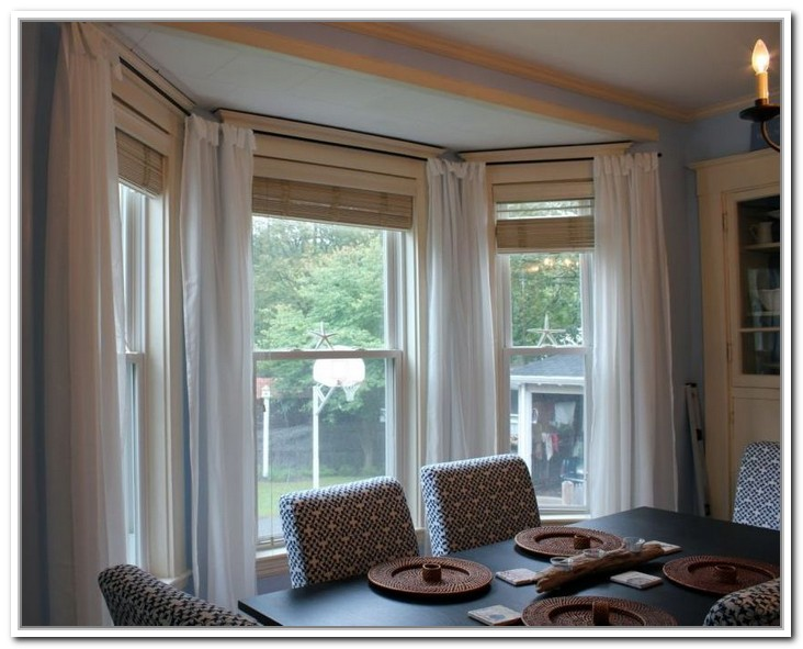 Small Bay Windows With White Long Drapes In Dining Room A Set Of Furniture