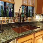 spanish tiles idea for kitchen backsplash unique decorative bottles in window glass luxurious  granite countertop in black with double deep sinks and black metal faucet