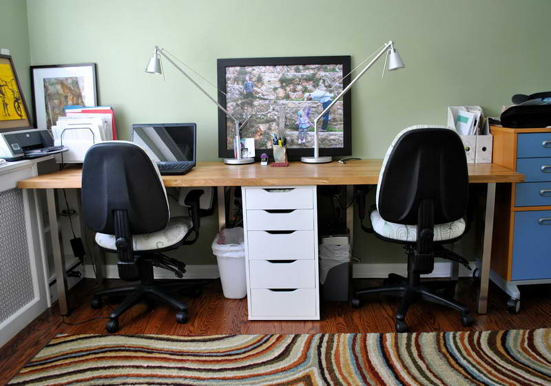 Two Person Office Desk With Drawers In The Center A Blue Door Storage  System Files