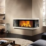 two-sided  view modern wood fireplace building in the corner of room black wood plank flooring idea white fury carpet in round shape  logs supplies and large built-in cabinet beside the fireplace