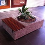 unique concrete planter media with wood planks beside it
