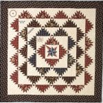unique prints quilt in brown and black tone