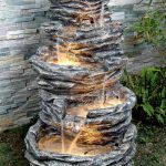 unique water feature for outdoor with several fountain features and small pool in every layer