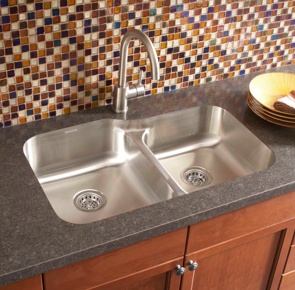 Vinyl Countertop With Double Deep Stainless Steel Sinks And Single Faucet A  Pile Of Small Flat