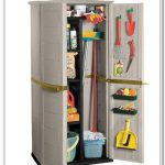 white cabinet for broom and other cleaning tools and cleaning supplies