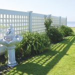 white-colored lattice fences with plants ornaments a unit of artistic sculpture in white color