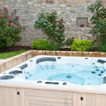 white large hot tub for outdoor beautiful outdoor park  with colorful flowers
