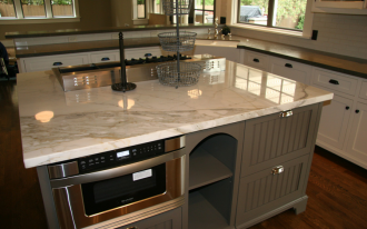 white marble countertop with modern kitchen applince storage and modern gas stove appliance on top hardwood floor for kitchen