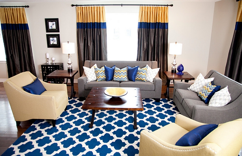 White Painted Wall Eyecatching Blue And White Rug Creame Leathered  Armchairs Gray Sofa Colorful Curtain Wooden