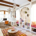 white painted wall white painted wall silve lantern shaped lamp beautiful patterned rug unique shaped bookcase unique wooden coffee table colorful cushion porcelain tiled floor moroccan living room